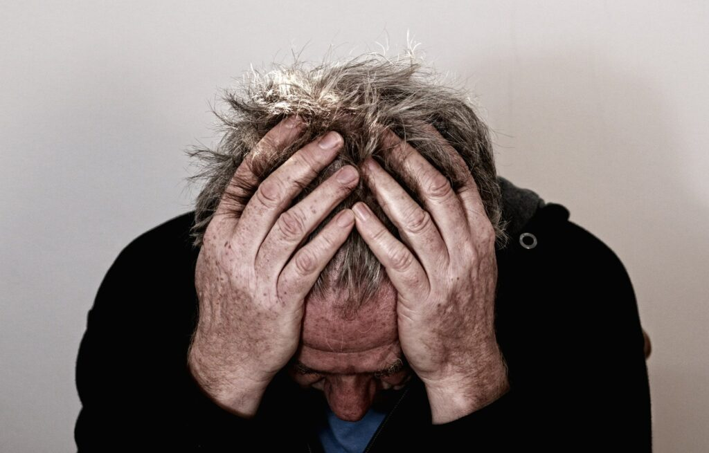 A photo of a man with a headache. Carlin Chiropractic: Chiropractor for Headaches