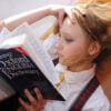 A photo of a girl reading a book. Free Spine Health Checks and Brain Health Checks for School Aged Kids: Carlin Chiropractic